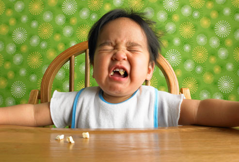 getty_rm_photo_of_toddler_crying_at_table_with_popcorn